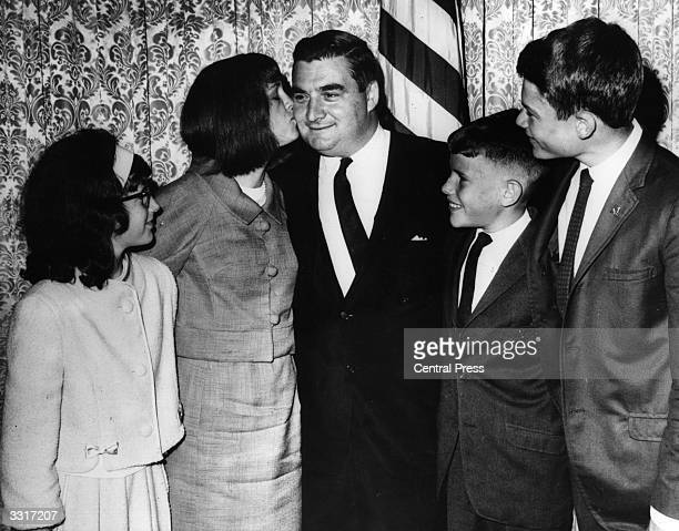Former White House Press Secretary Pierre Salinger being congratulated by his family after being sworn in as United States Senator from California