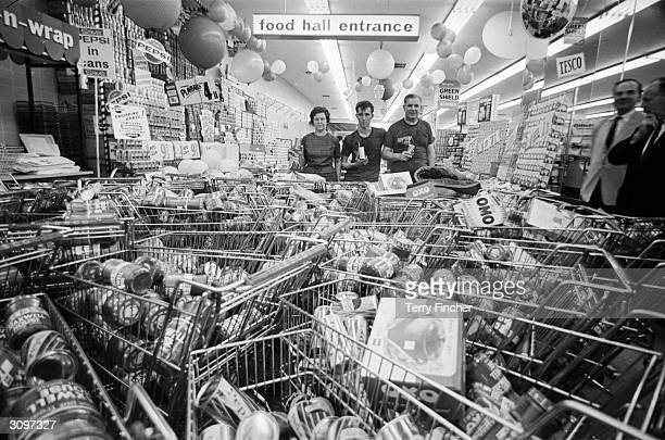 Mr and Mrs Buzidragis and their son Joe, winners of a US supermarket sweep contest repeat their prize-winning feat in a London Tesco.
