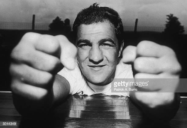 Closeup of American boxer Rocky Marciano clenching his fists Marciano was preparing for his fight against Ronald La Starza