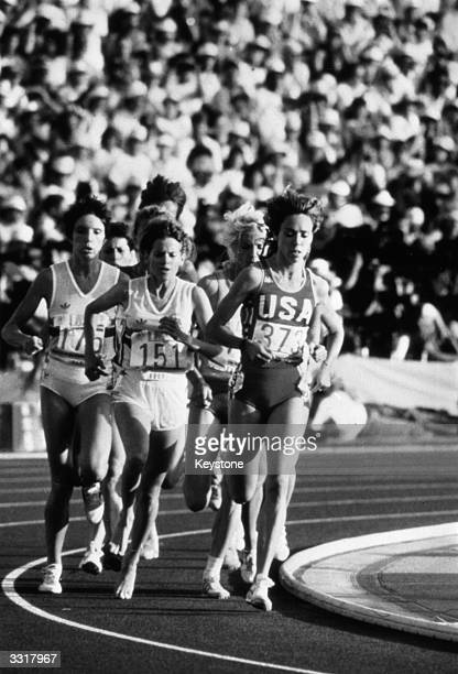 The women's 3000 metre race in the Los Angeles Olympics with left to right Wendy Sly of Great Britain Zola Budd of Great Britain Maricica Puica of...