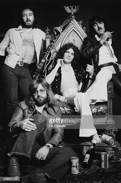 Scottish rock group Nazareth posed for their Loud 'n' Prould album session on 10th August 1973 Left to right bassist Pete Agnew drummer Darrell Sweet...