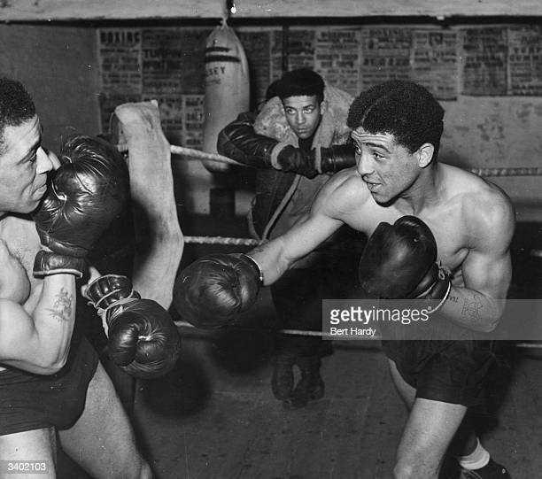 Brothers Dick and Randolph Turpin sparring Dick Turpin was the first coloured fighter to become British champion under B B B of C rules Randolph...
