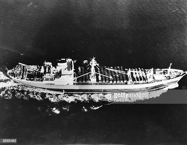 The Soviet ship 'Kasimov' at sea just off Cuba, with fifteen I1-28 aircraft on board. Fuselage crates on the ship were opened by the Soviet crew for...
