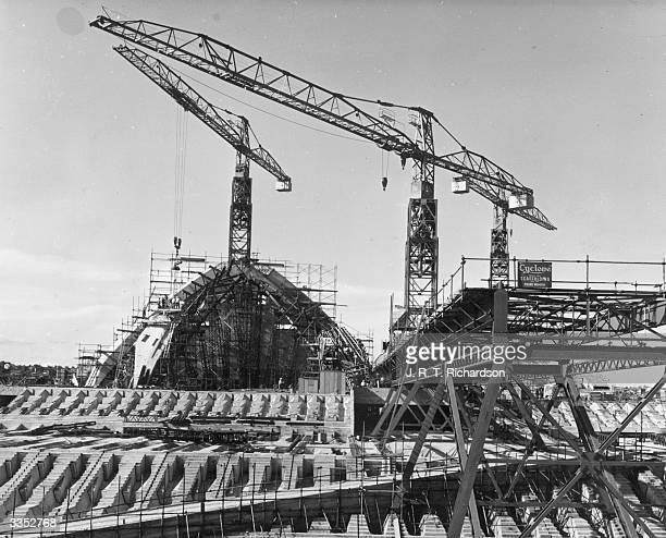 The roof is lifted onto the new Opera House being constructed in Sydney harbour New South Wales Designed by Danish architect Jorn Utzon and completed...