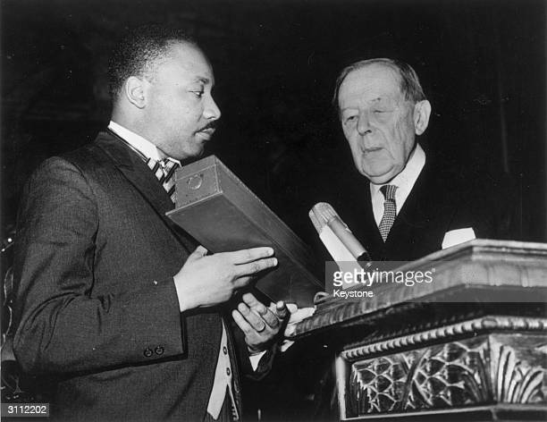 American civil rights leader Martin Luther King receives the Nobel Prize for Peace from Gunnar Jahn president of the Nobel Prize Committee in Oslo