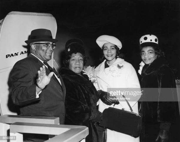 Relatives of Reverend Martin Luther King Jr board an airplane to attend the social reformer's Nobel Peace Prize presentation ceremony JFK...