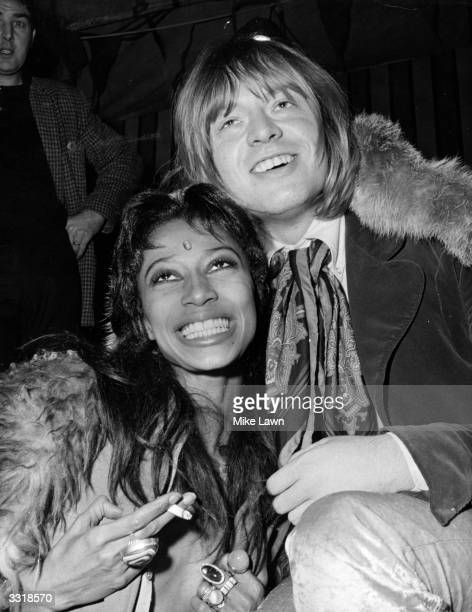 Brian Jones guitarist with the Rolling Stones and model Donyale Luna during filming of the television film 'Rolling Stones' Rock 'n' Roll Circus' at...