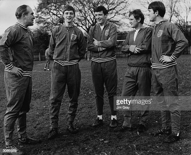 England manager Sir Alf Ramsey talks with three of the English soccer team training at the Bank of England Sports Ground Roehampton as they prepare...