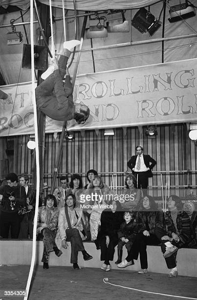 Watching a trapeze artist at Internel Studios in Stonebridge Park Wembley during a rehearsal for a TV spectacular The Rolling Stones Rock and Roll...