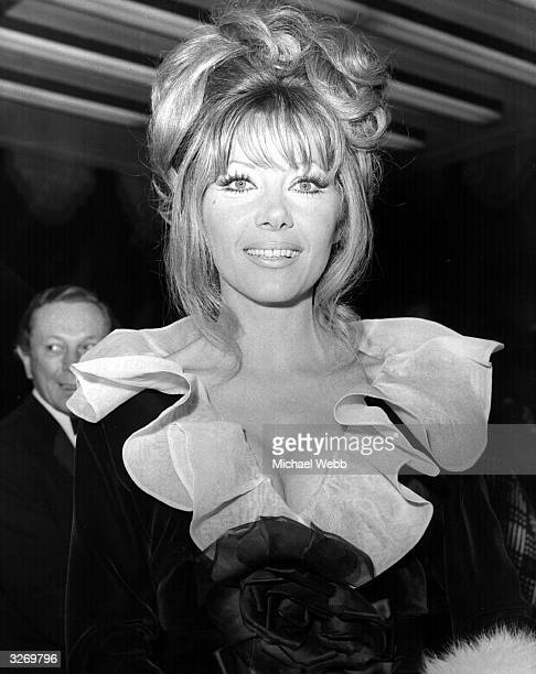 Actress Ingrid Pitt arriving for the premiere of 'Fiddler on the Roof' in London's Dominion Theatre