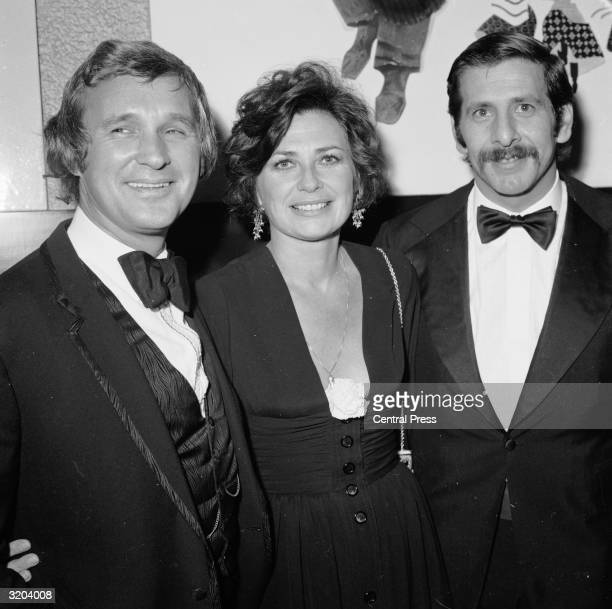 Film producer Norman Jewison film actress Norma Crane and Israeli actor Topol at the premiere of 'Fiddler on the Roof' at the Dominion in Tottenham...