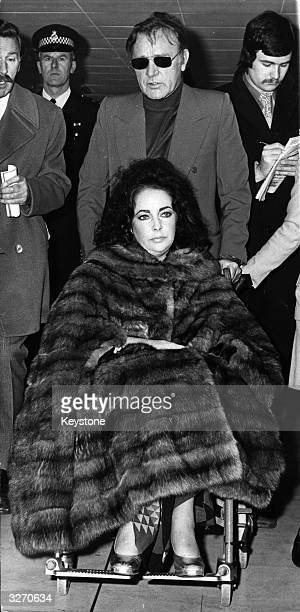 US actress Elizabeth Taylor who is recovering from an operation for the removal of an ovarian cyst with her husband Welsh actor Richard Burton at...