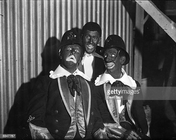 A group of London policeman made up as black and white minstrels for a charity show at the Chiswick Empire in aid of a local hospital