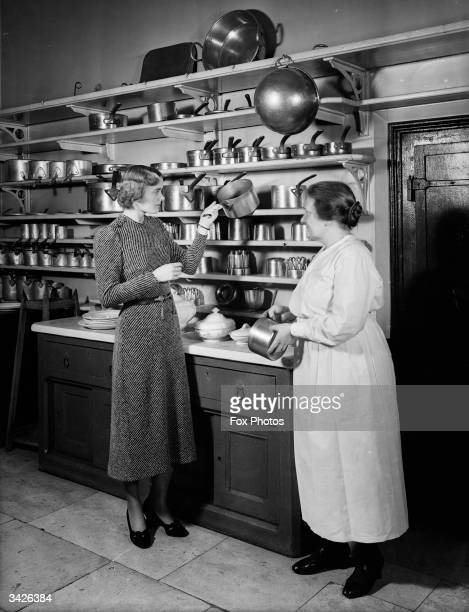 Mrs Cadd the Speaker's chef and his daughter Mary Fitzroy in the kitchen of the house of the Speaker of the House of Commons
