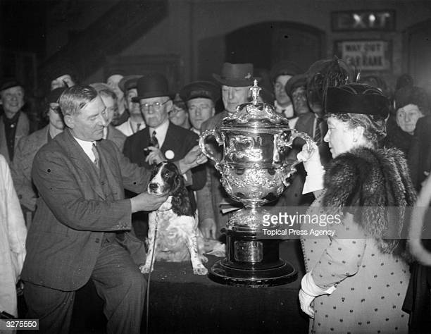 Mrs Cruft presenting the trophy at the Royal Agricultural Hall in London to Mr H S Lloyd whose cocker spaniel 'Exquisite Model Of Ware' was named as...