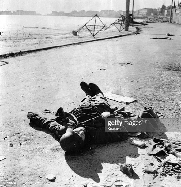 One of the few Germans who took up arms against the invading Fifth Army in the first stage of the surprise beach landing at Anzio lies where he fell...
