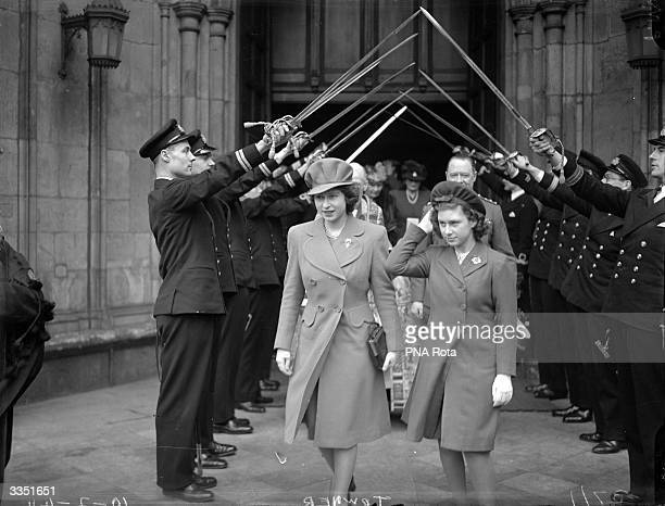 Princess Elizabeth and Princess Margaret leaving Westminster Abbey, London, under the guard of honour, after the wedding of Lt Wake Walker and Lady...