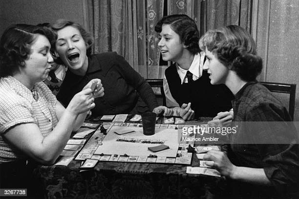 Year-old Sunday School teacher Veronica Hurst plays a game of Monopoly at home in Tooting with her mother and sisters. A RADA student, she has just...