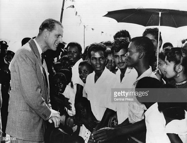 The Duke of Edinburgh talking to sugar estate workers on the occasion of his visit to British Guiana