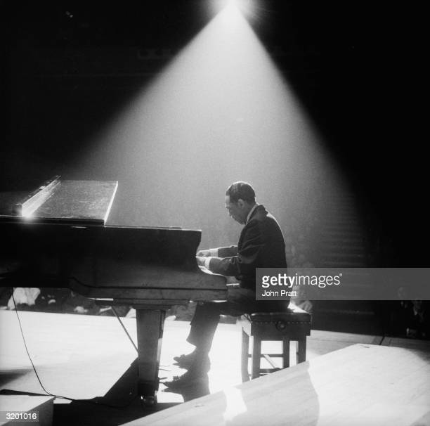 American jazz band leader and composer Duke Ellington at the piano at the Fairfield Hall Croydon during a British tour