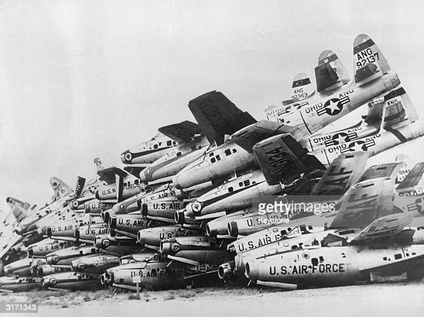 Defunct US Airforce planes piled up at an aircraft breakers yard