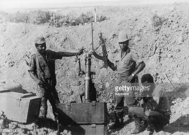 Members of the MPLA proudly display their weapons during the civil war in Angola