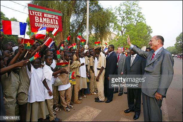 10Th FrenchSpeaking Summit French President Jacques Chirac Arrival At The Airport And Welcoming By The Ouagadougou Population On November 25 2004 In...