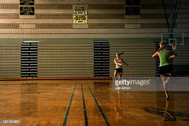 10th graders Olivia Quinn and Tia Cooper dance across the gymnasium floor in the morning light Monday at Monarch High School They are members of the...