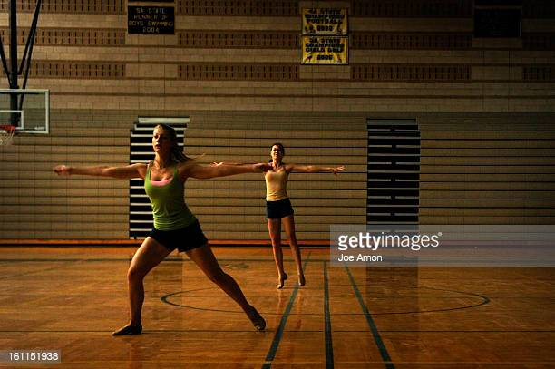 10th graders Tia Cooper and Olivia Quinn dance across the gymnasium floor in the morning light Monday at Monarch High School They are members of the...