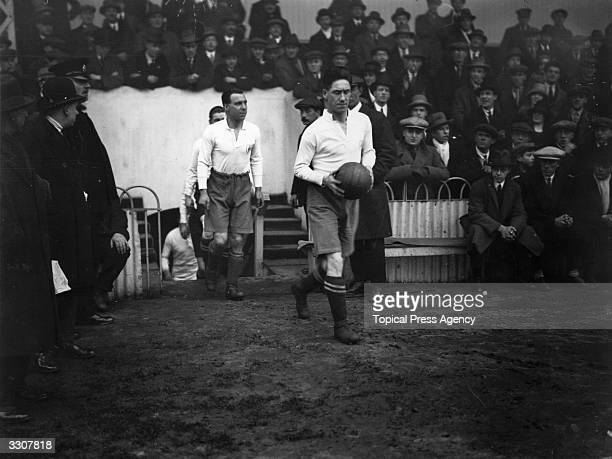 Jimmy Seed leads the Tottenham Hotspur team on to the pitch at White Hart Lane for their first round FA Cup match against Northampton Town