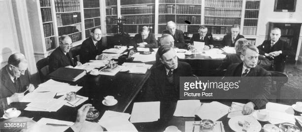 Meeting of the managers of the Royal Institution, a scientific research centre founded in London in 1799. Dr R E Slade, Professor Rankine, Mr T...