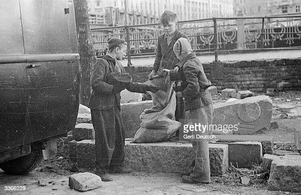 Children searching bombsites for fuel in postwar Vienna Original Publication Picture Post 4471 In Vienna Today A Foreign Correspondents Life pub 1948