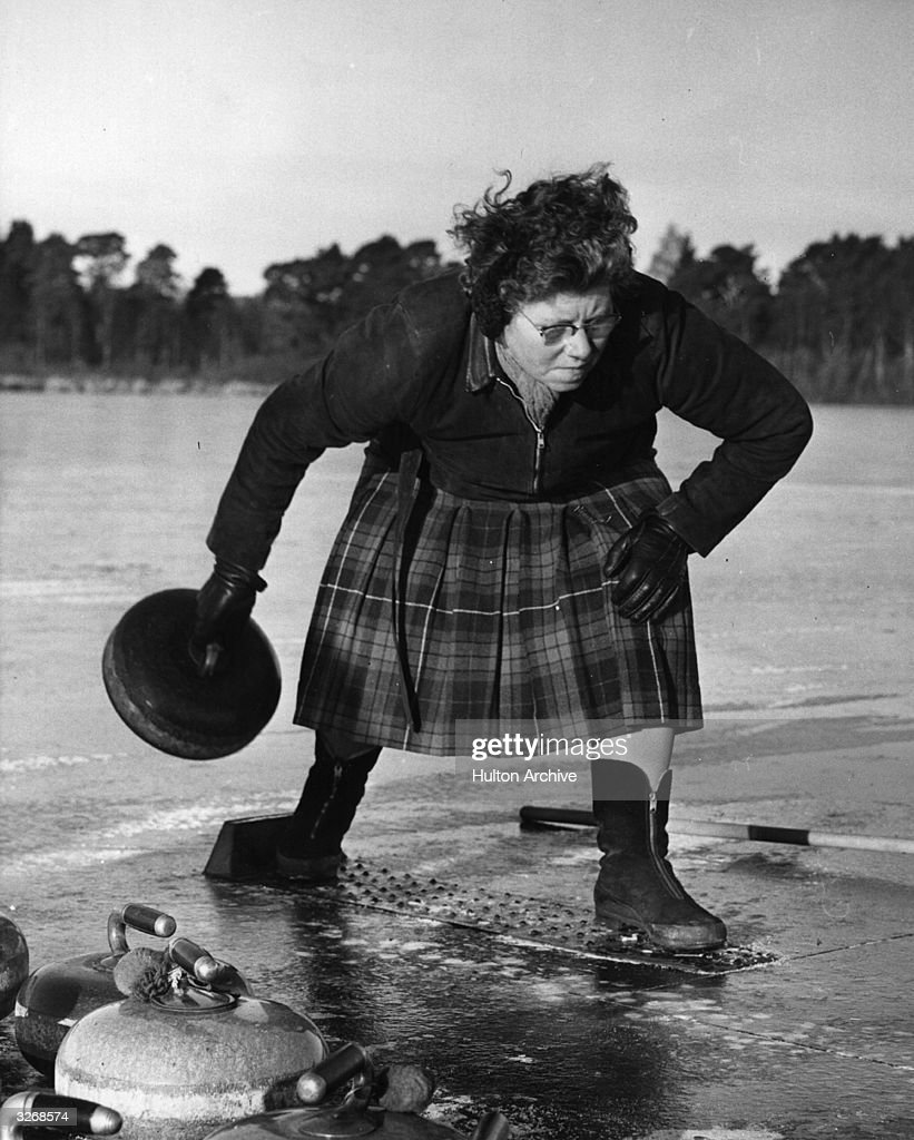 Mrs H Struthers was the only female competitor in this curling event on Stormont Loch in Perthshire. The precise origins of curling are unclear but the game was certainly being played in Scotland by the 16th century and it was here that equipment was developed and rules established. By the 18th century curling was a common past-time in Scotland and curling societies were commonplace. In 1804 the Duddingston Club set out the first 'Rules in Curling'. Scottish immigrants took the game to the United States and to Canada where it continues to thrive. Curling is played on ice with 42-pound granite stones. The stones are pushed along the playing surface (or 'sheet') towards the centre (or 'tee') of a circular target known as a house. Each team plays eight stones and after all sixteen have been played the winning team for that round (or 'end') is the one with the stone nearest to the tee. A typical games has ten or twelve ends. Curling is now an Olympic sport.