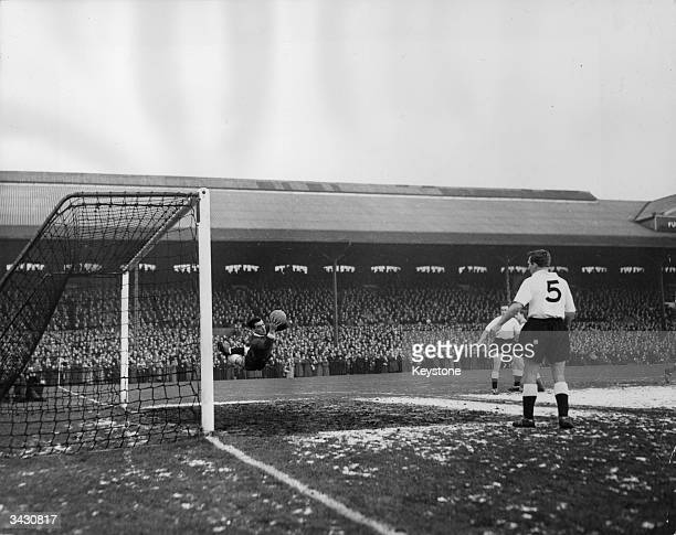 The Fulham goalkeeper making a flying save during a game against Peterborough at Craven Cottage London