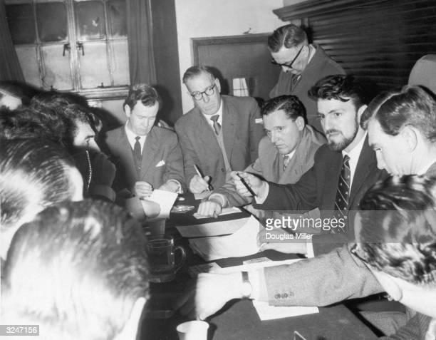 Jimmy Hill President of the Professional Footballers' Association talks to members of the press at St Pancras Town Hall London The topic in question...