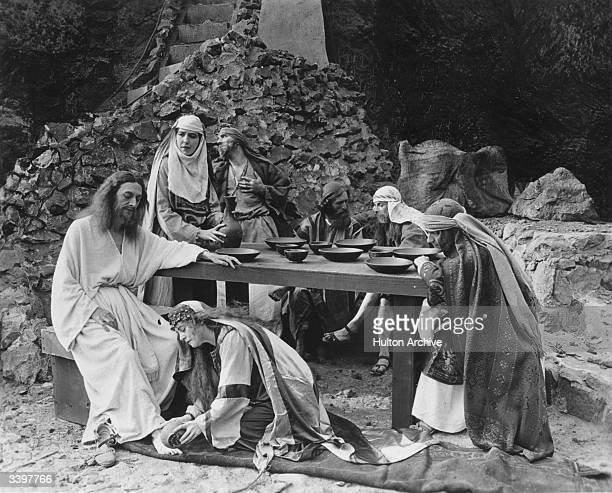 Scene from a Passion play depicting Mary anointing the feet of Jesus enacted in Los Angeles, California.