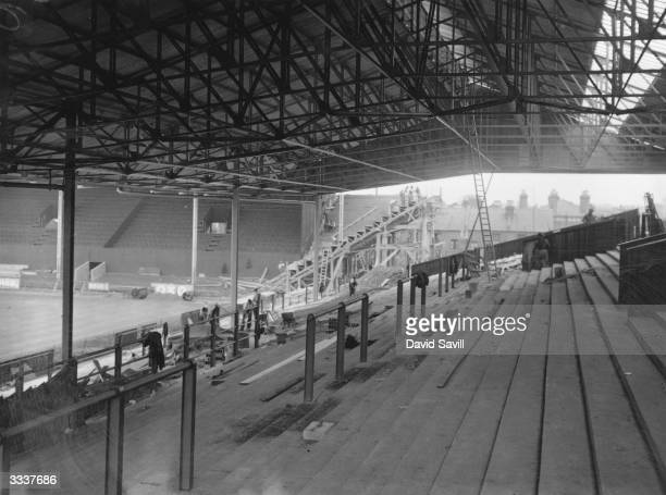 The new grandstands being erected at the Brentford Football Club's ground, London, following their promotion to the First Division.