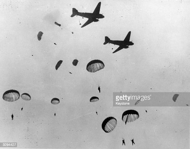 Paratroopers jumping from their Douglas C 47 Skytrain aircraft.