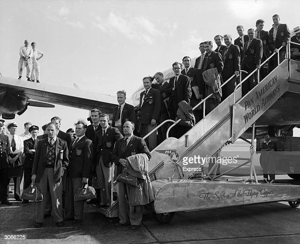 The England football team arrives back at London Airport from Rio after failure in the World Cup Standing at the bottom of the airplane steps are...