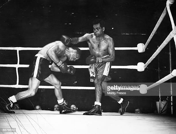 Empire middleweight boxing champion Dave Sands of Australia in action against Mel Brown of the USA during their fight at Earls Court London