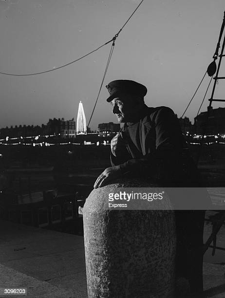 Mr Corquarilly Ramsgate lifeboat coxswain leans on a quayside bollard