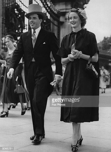 The actress Elspet Gray and her husband actormanager Brian Rix arrive at Buckingham Palace London for a royal garden party attended by Queen...