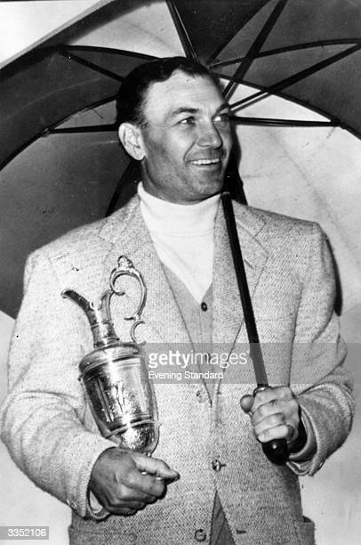 Professional American golf star Ben Hogan with the British Open trophy after winning the tournament by four strokes