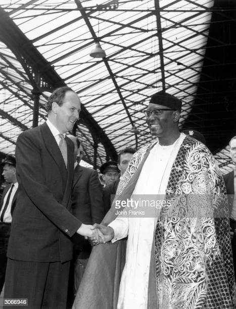 Dr NNamdi Azikiwe GovernorGeneral of Nigeria on a visit to London being welcomed by the Duke of Devonshire at Euston station