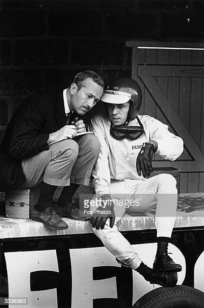 British motor racing driver Jim Clark with the manager of Lotus cars, Colin Chapman in the pits at Brands Hatch in Kent.