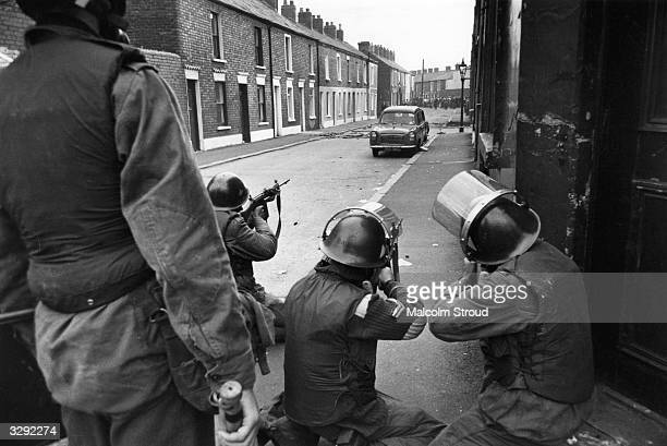 British soldiers take aim at civil rights demonstrators in the Falls Road Belfast