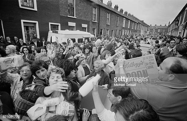 Irish women handing out food at a civil rights march in the Falls Road Belfast Northern Ireland
