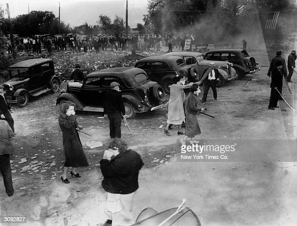 American police use tear gas against women pickets at the Newton Steel Company Monroe Michigan