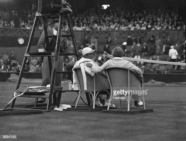 American tennis player Alice Marble resting between games at Wimbledon during the 16th Wightman Cup between women of Great Britain and the USA