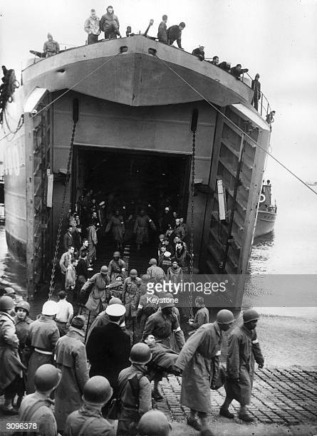 Wounded American soldiers being brought ashore in Britain